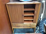 Sale 8728 - Lot 1085 - 1960s Danish Fruitwood Raised Cabinet, with two tambour shutters enclosing slides & shelves, with five drawers below & tapering legs...