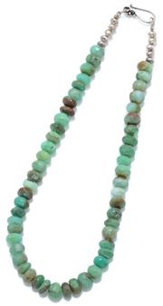 Sale 9046 - Lot 570 - A GREEN QUARTZ BEAD NECKLACE; 10mm faceted beads to silver S hook clasp, length 43cm, wt. 49.12g.