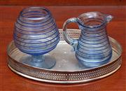 Sale 9055H - Lot 84 - A hand-blown blue swirl art glass goblet together with matching jug on a silver plated galleried tray. Height of goblet:10cm