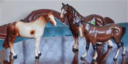 Sale 9103M - Lot 456 - A Melba ware stallion, Height 20cm, with two other glazed horses