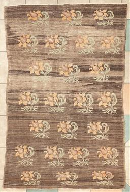 Sale 9130H - Lot 42 - A contemporary Afghani Woolen rug with floral sprays in grid pattern over a tawny ground, 110 x 160cm