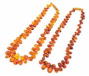 Sale 8879 - Lot 327 - TWO AMBER GRADUATED BEAD NECKLACES; 5-15mm tumbled reconstituted amber beads, length 46cm.