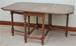 Sale 9103M - Lot 583 - A gateleg extension table over turned supports, Height 72cm x extended Width 154cm x Depth 104cm