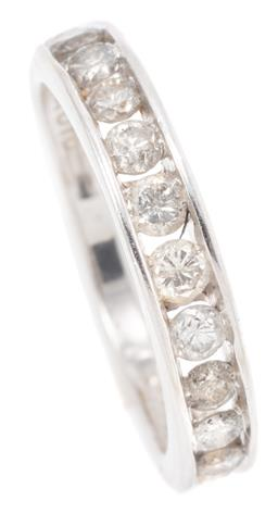 Sale 9149 - Lot 447 - A DIAMOND ETERNITY RING; 3/4 hoop channel set in 10ct white gold with 14 round brilliant cut diamonds totalling approx. 0.90ct P1-2...