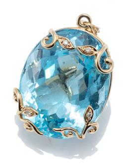 Sale 9160 - Lot 368 - A 9CT GOLD TOPAZ AND DIAMOND PENDANT; set with an oval cut blue topaz of approx. 29ct with leaf and vine claws, further set with 4 r...