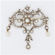 Sale 8250 - Lot 59 - A VICTORIAN DIAMOND BROOCH; silver set on 9ct ct gold featuring a central cluster of old round cut diamonds to a surround old round...