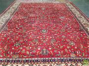 Sale 8465 - Lot 1027 - Large Persian Kashan Wool Carpet, with floral arabesques on a red ground & cream border (400 x 300cm)