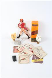 Sale 8748 - Lot 12 - Small Collection of Johnnie Walker Items inc Early Cards, Coasters, Lighter, Corks and Others