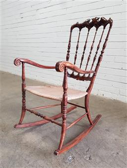 Sale 9126 - Lot 1112 - Victorian/ Edwardian Beech Rocking Chair, with delicate spindle back, wicker seat (damage to seat, h:100 x w:52x d:42cm)