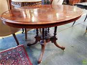 Sale 8598 - Lot 1098 - Victorian Figured Walnut & Marquetry Oval Loo Table, with floral inlays to the centre & border, on a turned pedestal with outswept legs