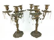Sale 8995H - Lot 1 - A pair of bronze three branch candelabras decorated with fish and acanthus motifs with glass prism drops, height 40cm