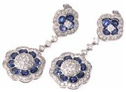 Sale 8937 - Lot 396 - A PAIR OF 14CT WHITE GOLD SAPPHIRE AND DIAMOND DOUBLE CLUSTER DROP EARRINGS; each a central cluster of 24 round brilliant cut diamon...