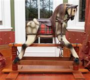 Sale 9020H - Lot 4 - A vintage rocking horse with leather saddlery on a pine base H 108 xL 135cm