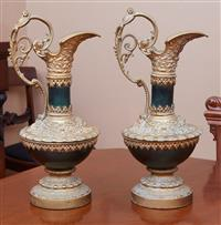 Sale 9080H - Lot 21 - A pair of classical from gilded spelter ewers with mark head and scrolling foliate decoration, Height 41cm