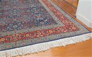 Sale 8470H - Lot 316 - A Hereke wool carpet with clusters of flowers on a dark blue ground, 289 x 201cm