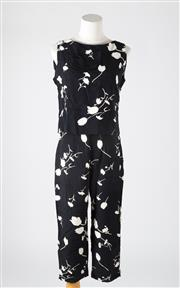 Sale 8541A - Lot 79 - An Adrienne Vittadini black and white floral print-suit with crop top and three quarter length pants, size small (8)