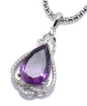 Sale 8937 - Lot 468 - AN AMETHYST AND DIAMOND PENDANT NECKLACE; featuring an approx. 11.70ct pear cut amethyst surrounded by 41 round brilliant cut diamon...