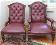 Sale 8470H - Lot 319 - A Victorian carved mahogany gentlemans and ladies chair, both upholstered in a buttoned burgundy leather, raised on turned reeded l...