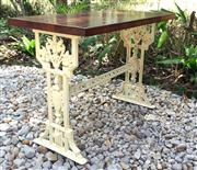 Sale 8706A - Lot 86 - An antique decorative cast iron leg table with refurnished timber top, H 73 x L 99 x W 50cm