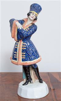 Sale 8963H - Lot 32 - A Goldscheider Vienna pottery figure of a Cossack woman designed by Laurenzl marked XXIII Height 31cm