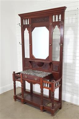 Sale 9179 - Lot 1091 - Late Victorian Walnut Hallstand, with carved panels & mirror, above a mottled black marble top and a drawer, raised on turned suppor...