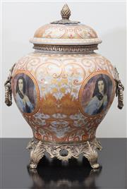 Sale 8562A - Lot 171 - A heavy gage ceramic lidded urn with gilt metal mounts, ring pull handles, and pineapple finial, decorated with portraits in roundel...