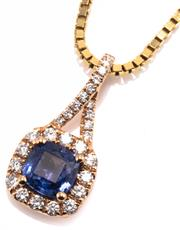 Sale 8937 - Lot 417 - A SAPPHIRE AND DIAMOND PENDANT NECKLACE; cushion form pendant centring an approx. 1.36ct blue cushion cut sapphire to surround and t...