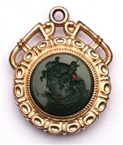 Sale 9078 - Lot 54 - A 19th Century Style Gilt Intaglio Bloodstone and Gold Stone Fob Medal, H:20cm