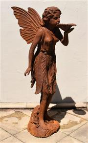 Sale 9087H - Lot 233 - A large cast iron statue of a fairy with aged rust patina. 1.45m height, 95cm depth