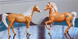 Sale 9103M - Lot 458 - A Beswick swish tail palomino horse with one raised leg, Height 17cm together with a standing palomino Height 16cm, chip to ear