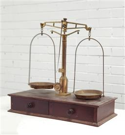 Sale 9134 - Lot 1497 - Antique brass scales on timber base with 2 drawers (h67 x w67 x d32cm)