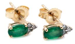 Sale 9213 - Lot 310 - A PAIR OF 14CT GOLD EMERALD AND DIAMOND STUD EARRINGS; each an oval emerald surmounted by 3 single cut diamonds, length 7.5mm, wt. 0...