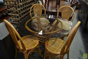 Sale 8480 - Lot 1035 - Cane 5 Piece Dining Suite inc Round Glass Top Table and 4 Chairs