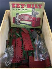 Sale 8567 - Lot 741 - A Large Quantity of Metal Construction Pieces for Australian 'Ezy-Bilt' model toy-making, with two instruction books for sets 1-8