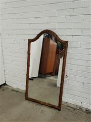 Sale 9068 - Lot 1009 - Gilt Arched Top Mirror, the reeded frame tied by leaves (h:125 x w:67cm)
