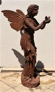 Sale 9087H - Lot 234 - A large cast iron statue of a fairy with aged rust patina. 1.45m height, 95cm depth