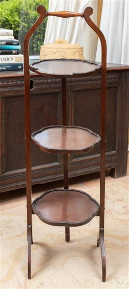 Sale 9120H - Lot 197 - A foldable mahogany three tier afternoon tea stand, Height 91cm, minor losses