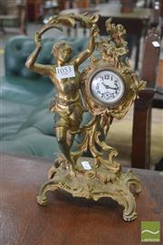 Sale 8267 - Lot 1053 - American Gilt Brass Figural Table Clock, with scantily clad youth, the movement stamped May 29, 1894