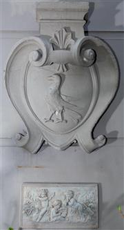 Sale 8568A - Lot 15 - A Baroque style large composite shield shaped armorial with a crow, H 81cm, together with a musical cherubs plaque