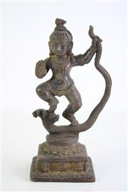 Sale 8840S - Lot 637 - Bronze Figure of a Buddha Holding a Zoomorphic Snake, H22cm