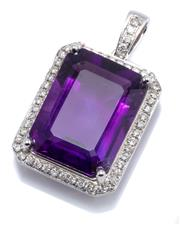Sale 8937 - Lot 476 - AN 18CT WHITE GOLD AMETHYST AND DIAMOND PENDANT; featuring an approx. 9.25ct emerald cut amethyst to surround and bale set with 52 r...