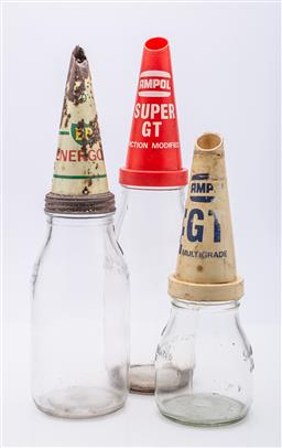 Sale 9185 - Lot 5 - Collection of early glass oil bottles two with plastic Ampol flutes and one metal BP (H:37cm to 27cm)