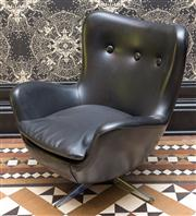 Sale 8222 - Lot 18 - A C20th style armchair with black leather upholstery and three buttoned back