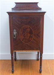 Sale 8470H - Lot 332 - A 1920s inlaid mahogany bedside cabinet the door with oval panel and on turned legs, 82cm, needs attention