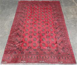 Sale 9126 - Lot 1053 - Afghani hand knotted pure wool Turkoman Carpet, with four columns of guls, in deep red and black tones (232 x 153cm)