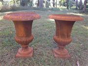 Sale 8579 - Lot 1 - A pair of rustic cast iron urns with surface rust, H 42 X Diameter 35cm