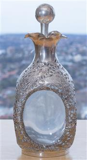 Sale 8593A - Lot 43 - A Chinese silver encased dimple effect glass decanter with pierced dragon design, H 27cm