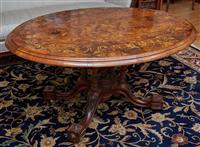 Sale 9080H - Lot 40 - A Victorian walnut inlaid loo table corner veneered and inlaid with rose and scroll motif on a birdcage base, height 66cm, Width 142...