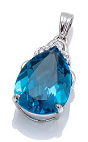 Sale 9095 - Lot 358 - AN 18CT WHITE GOLD TOPAZ AND DIAMOND PENDANT; claw set with an approx. 5.8ct fine pear cut blue topaz surmounted by 3 round brillian...