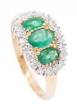 Sale 9169 - Lot 341 - A VICTORIAN INSPIRED EMERALD AND DIAMOND RING; set across the top with 3 graduated oval cut emeralds to oval border of 20 round cut...